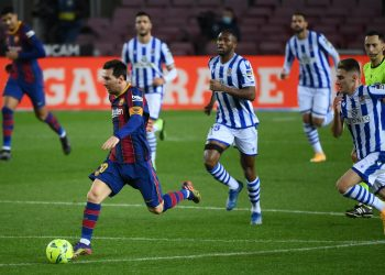 Barcelona's Argentinian forward Lionel Messi runs with the ball during the Spanish league football match between FC Barcelona and Real Sociedad at the Camp Nou stadium in Barcelona on December 16, 2020. (Photo by LLUIS GENE / AFP)