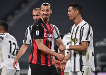 TOPSHOT - AC Milan's Swedish forward Zlatan Ibrahimovic (C) and Juventus' Portuguese forward Cristiano Ronaldo (R) react during the Italian Serie A football match Juventus vs AC Milan on May 09, 2021 at the Juventus stadium in Turin. (Photo by Marco BERTORELLO / AFP)